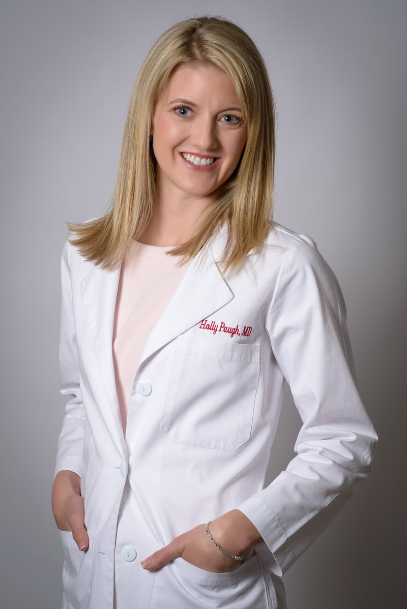 Female doctor poses for in studio headshot