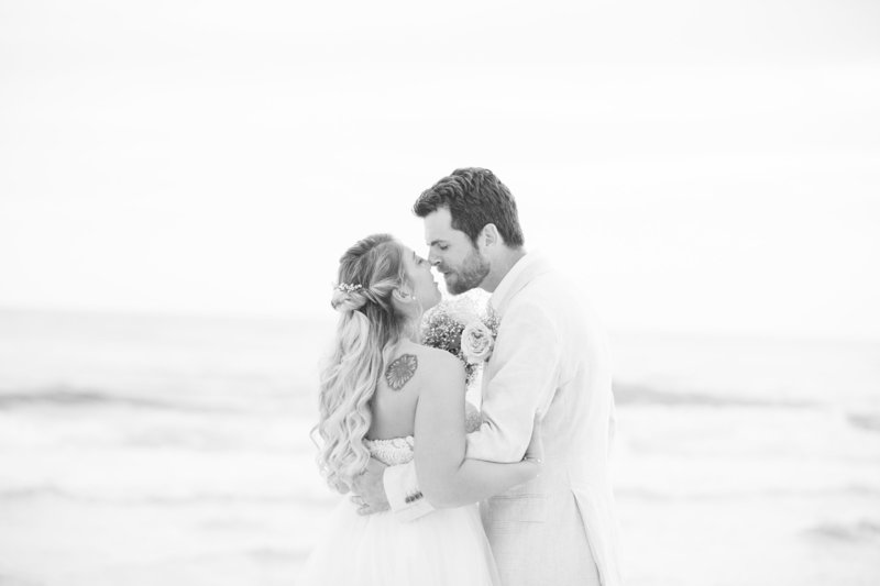 bride and groom pose for wedding day portraits on the beach in Charleston