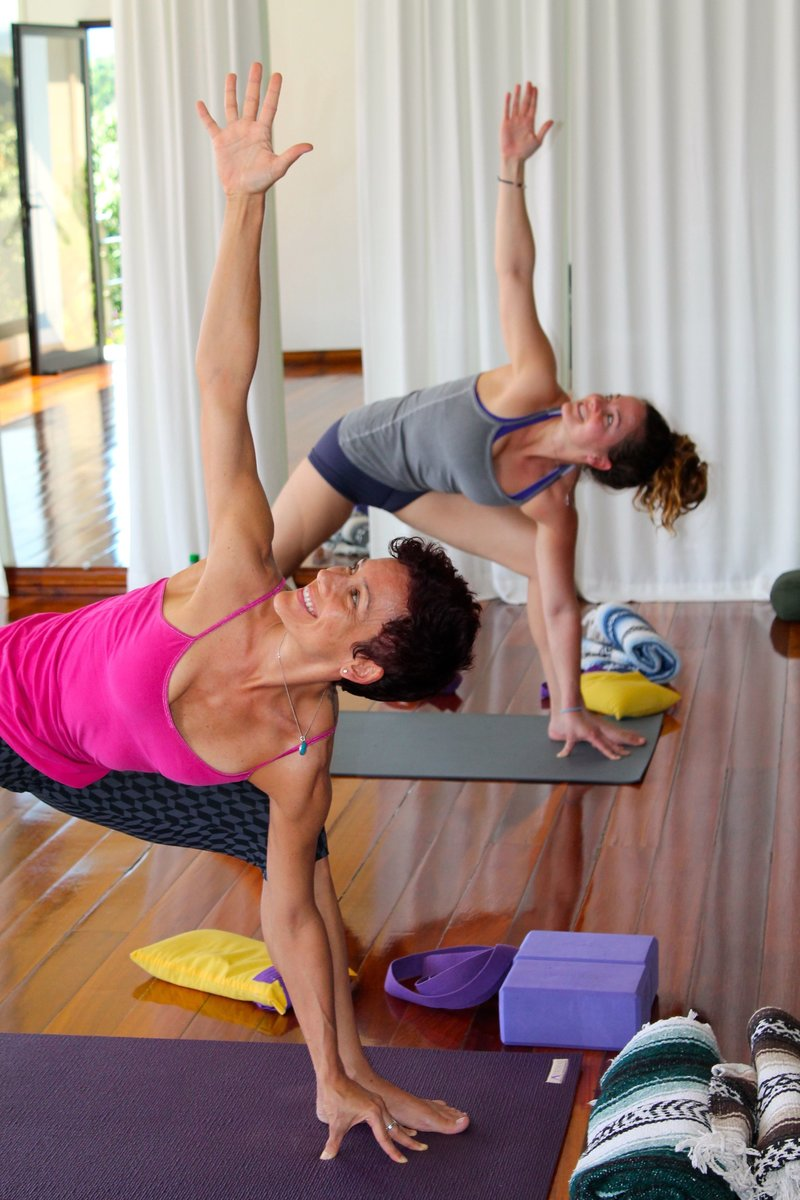 Two women doing yoga  - Soma Yoga Institute