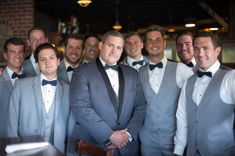 Groom and his groomsmen  pose for photo at the Tap House in Erie, PA