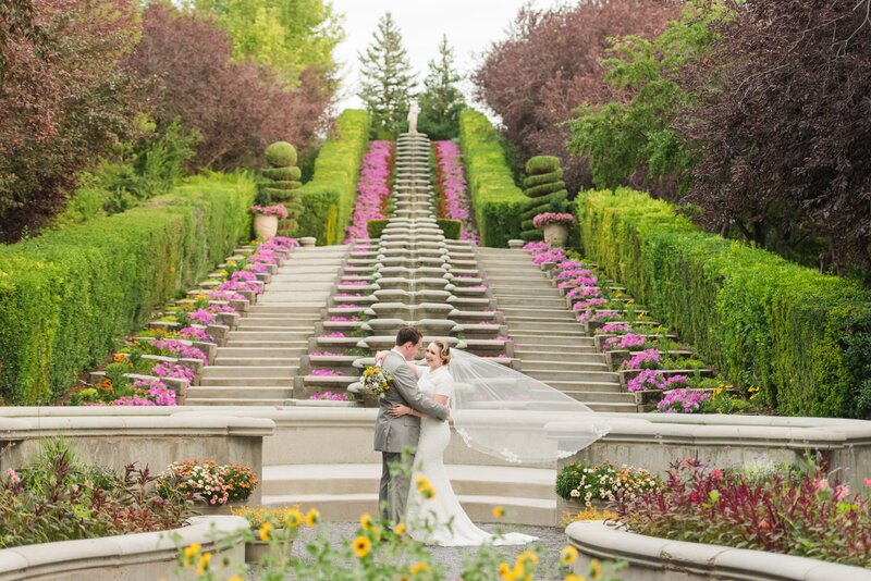 Bride and groom at the Italian Garden at Thanksgiving Point