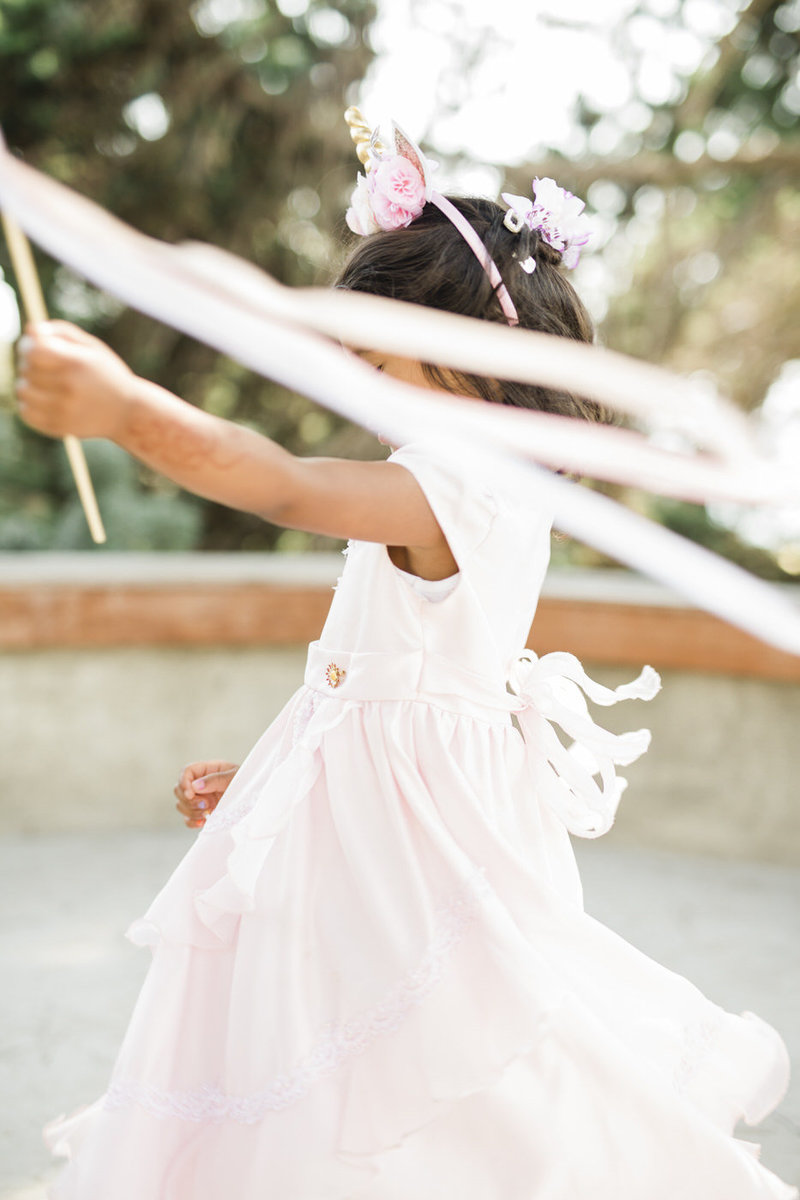 wedding at the Martin Johnson house in La Jolla- a candid photo of a flower girl