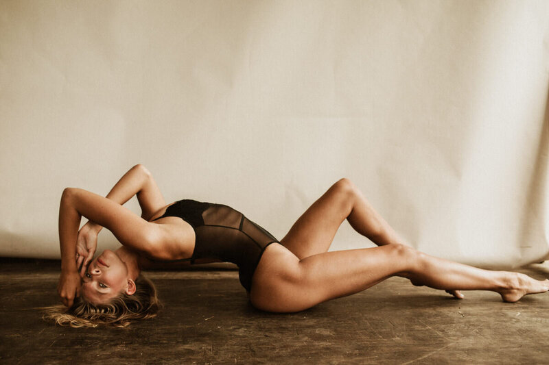 woman laying on floor in lingerie