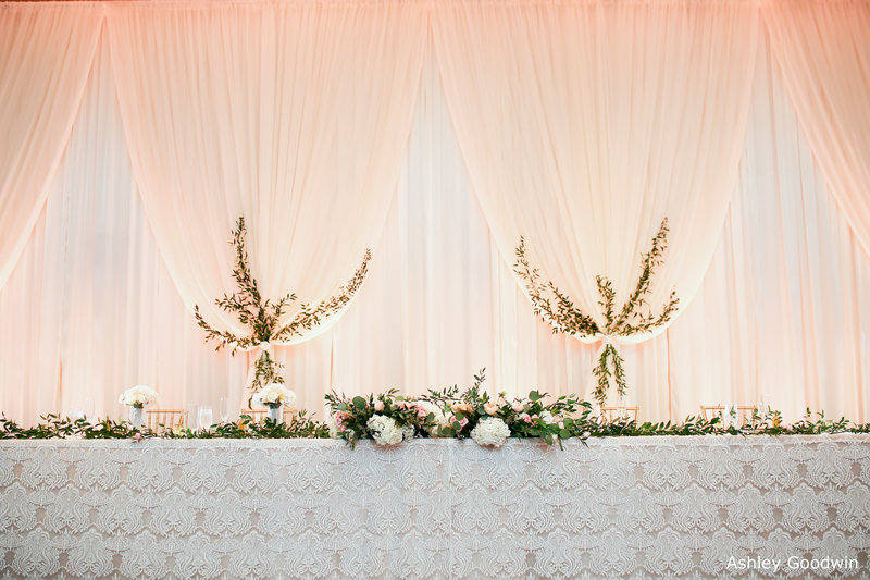 WM Pipe and drape chiffon bunches head table linen