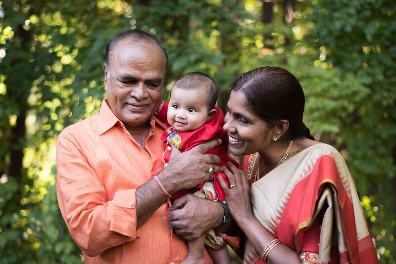 Indian grandparents holding a baby