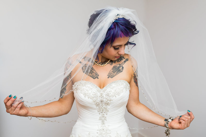 Portrait of the tattoed bride on her wedding day in Allentown PA