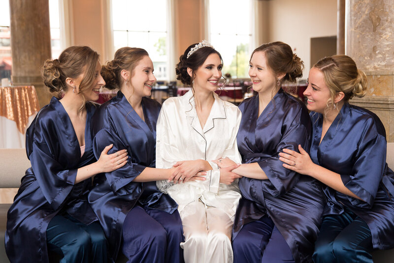 bridesmaids in blue robes at cityflats ballroom port huron