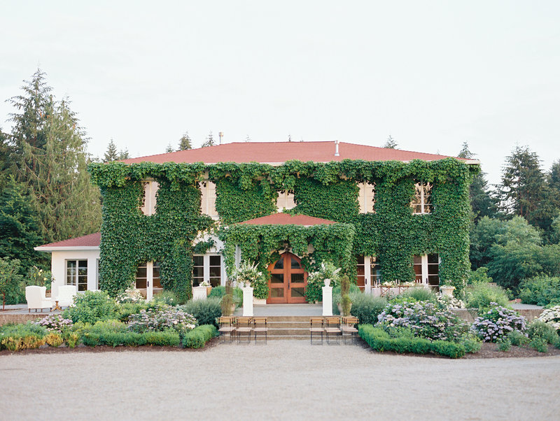 Monet Vineyards - an European estate covered in ivy setup for a wedding ceremony