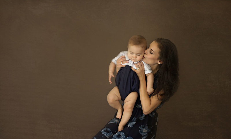 Studio portrait of mother and 9 month old baby taken at Melody Yazdani Studios in Vienna, Virginia.  Realtor Alexandra Shor enjoyed a relaxing professional makeover before her portrait session with her nine month old son.