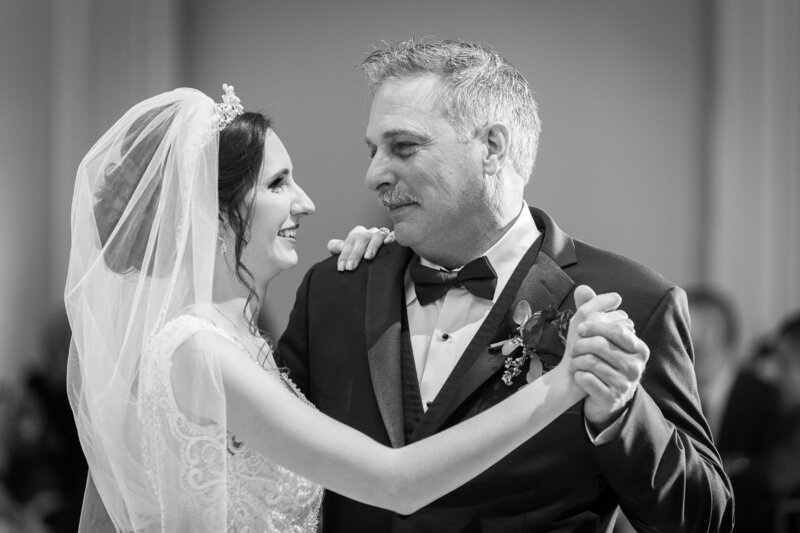 father daughter dance on wedding day at cityflats ballroom port huron
