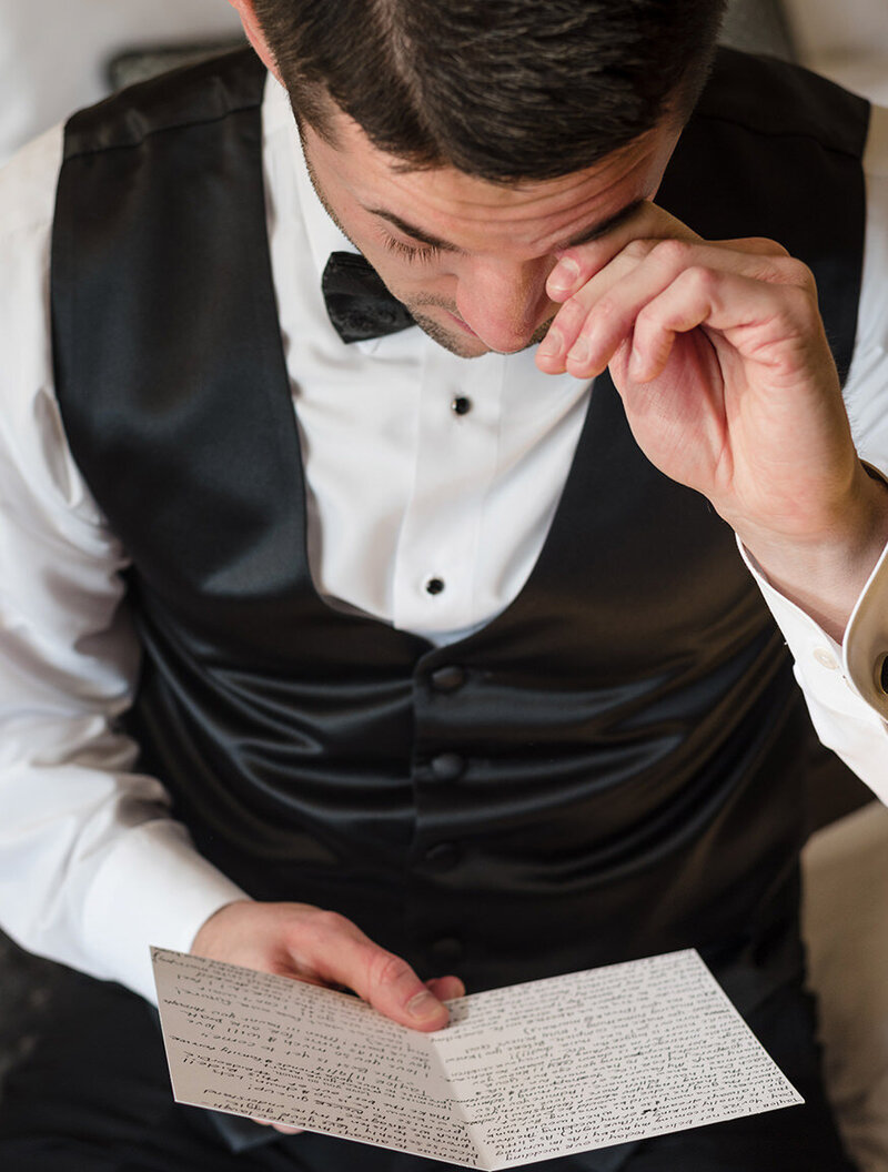 groom-crying-letter-reading-white-quill-creative