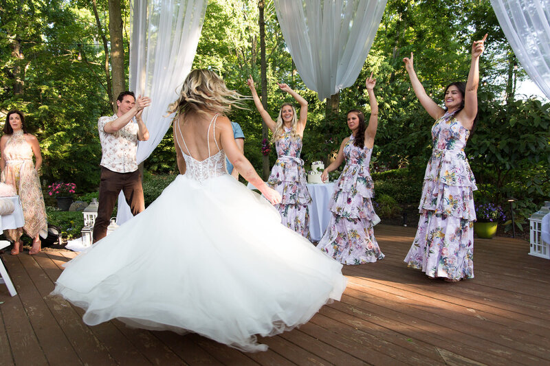 bride spins in wedding dress backyard covid wedding