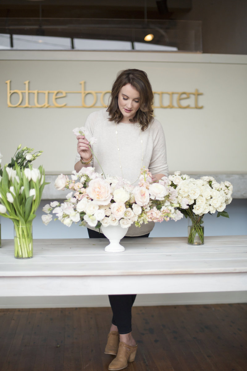 Floral Designer making a wedding centerpiece