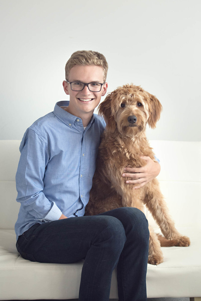 Guy senior picture with dog photographer St. paul