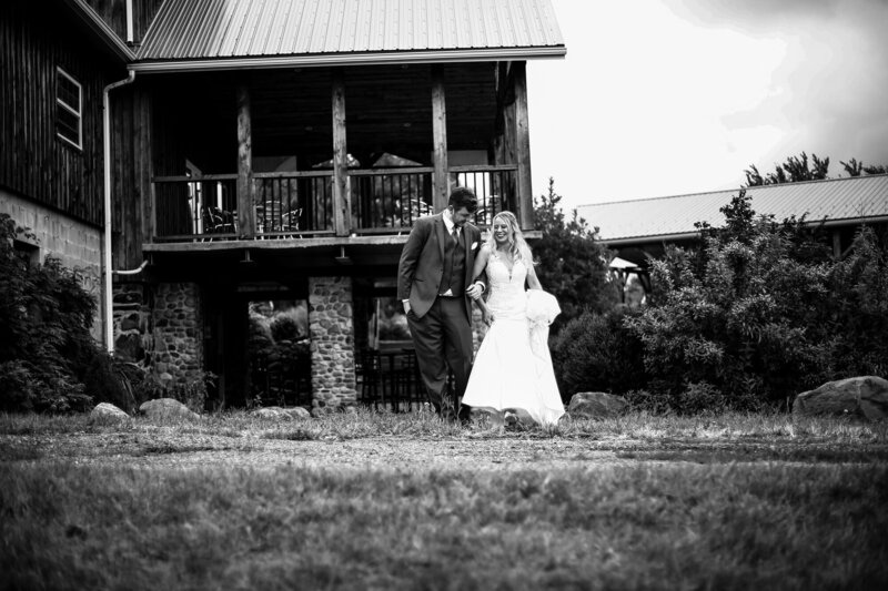 Bride and groom walk the grounds of Quincy Cellars before their wedding