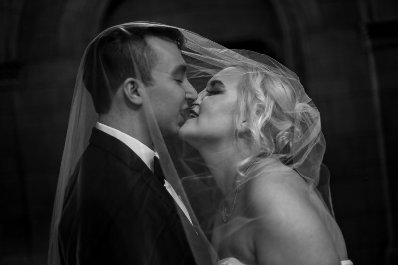 Bride and groom about to kiss under the veil at the Cathedral of Learning in Pittsburgh, PA