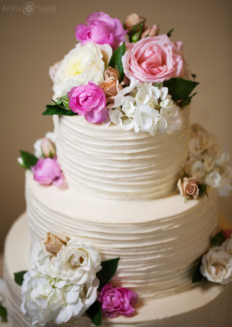 Four-Tier-White-Wedding-Cake-with-Florals-by-Blue-Moon-Bakery-in-Dillon-Colorado-2
