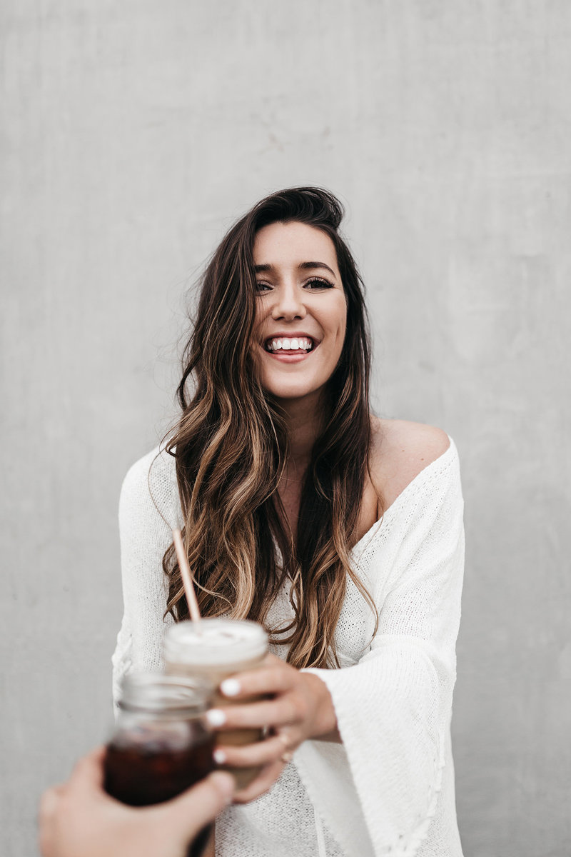 athena-grace-coffee-concrete-wall-white-dress-laugh