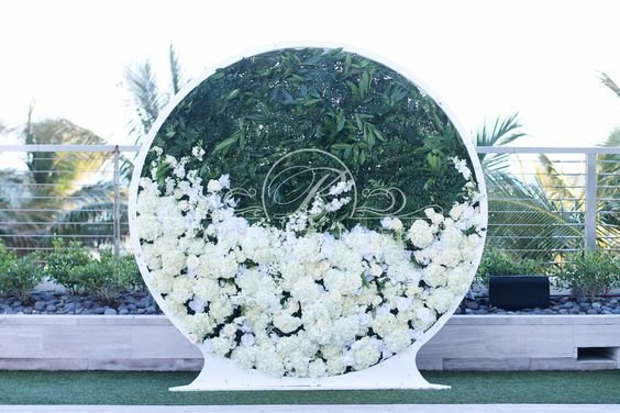 circle wedding arch green and white weddings