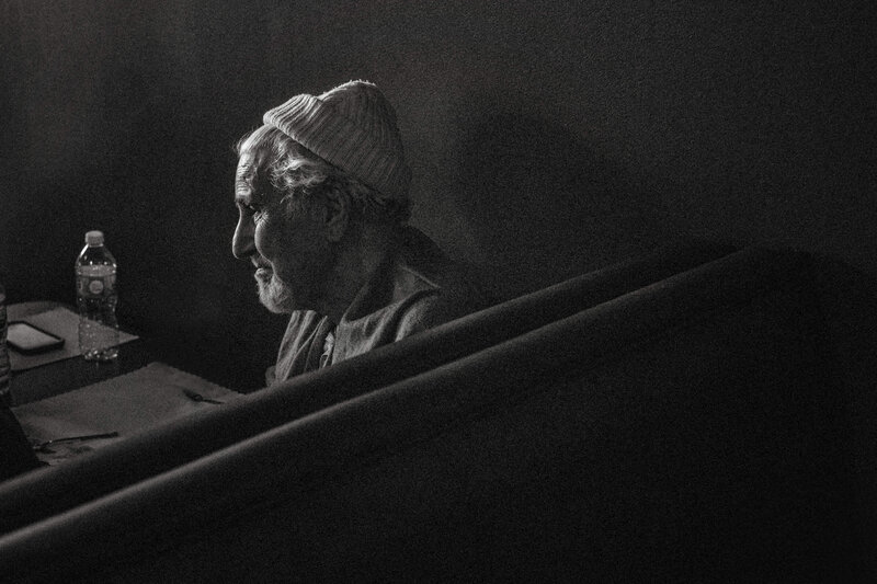 elderly man with grey hair and toque in beautiful window light