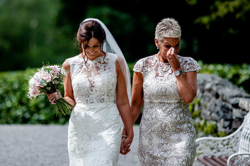 bride and mother walk down the aisle - outdoor wedding