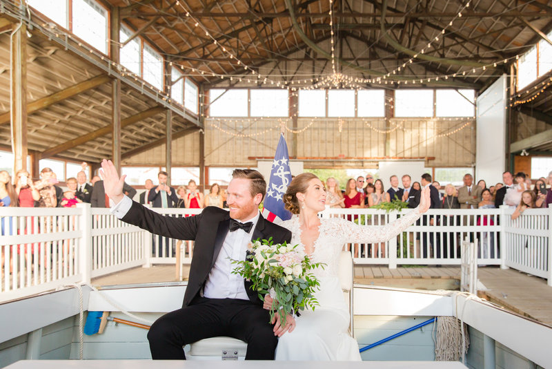 Couple leaving ceremony on a boat