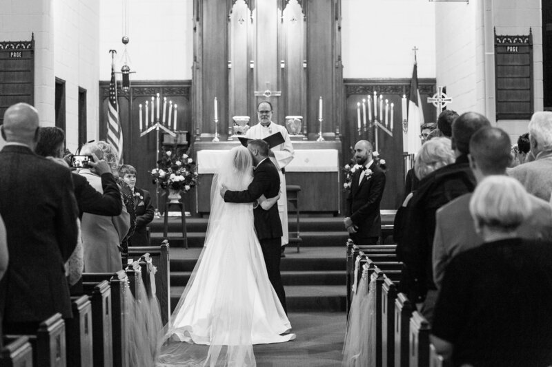 dad hugs bride at trinity lutheran church port huron