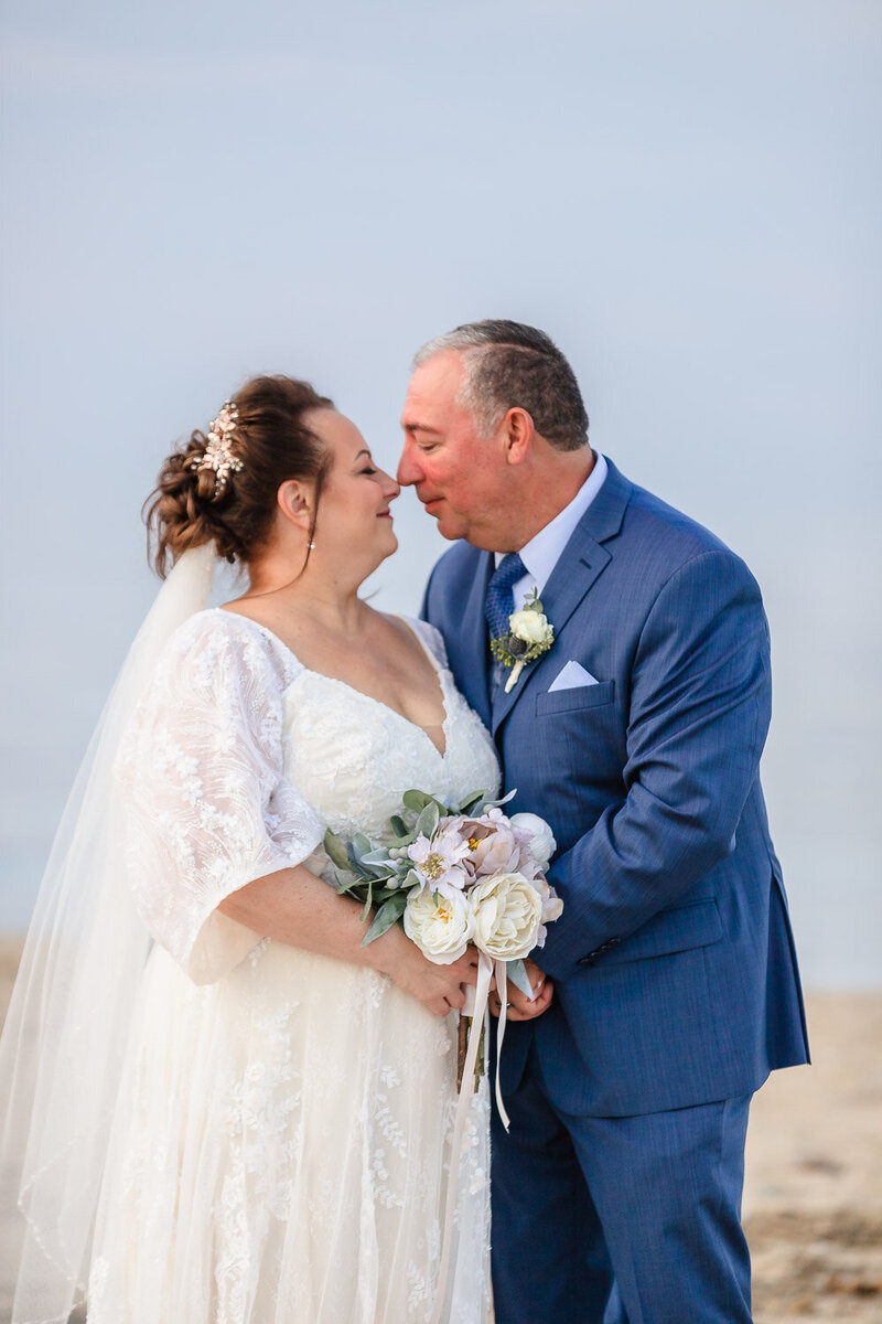 Beach wedding couple portrait in Lewes Delaware.