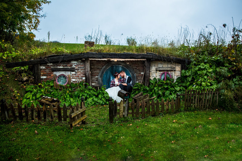 Couple sitting by a hobbit hole