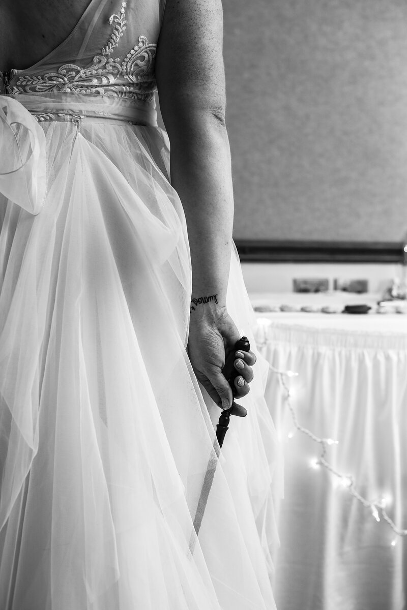 Bride holds wand and displays Harry Potter wrist tattoo