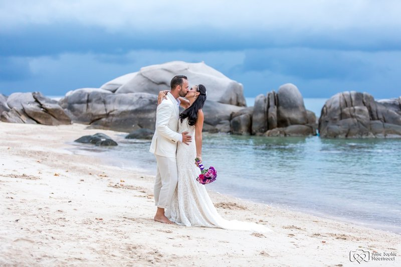 Bride and Groom kissing on beach Thailand