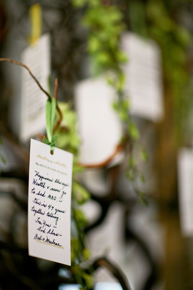 Written wedding notes on tree