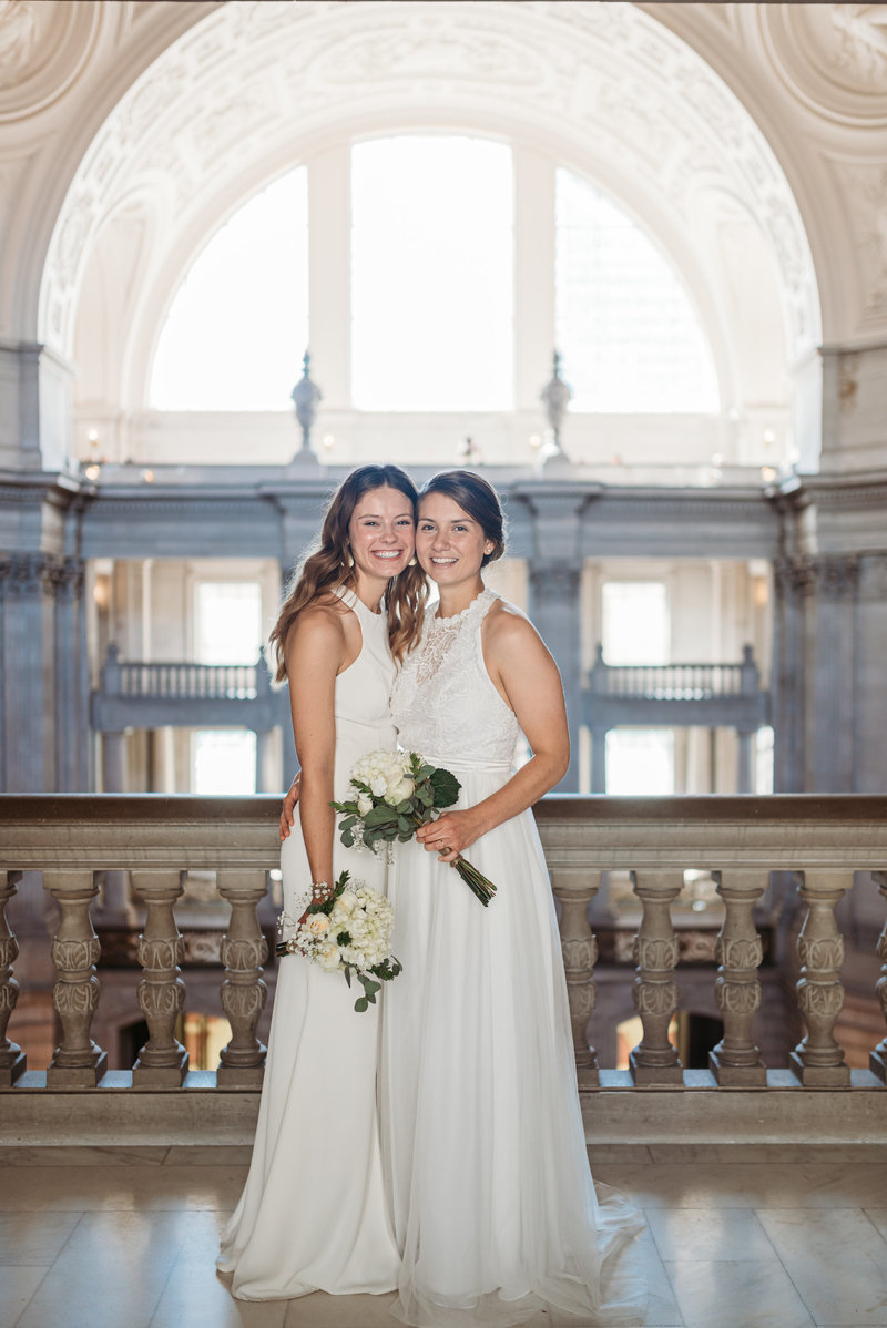 Brides at San Francisco City Hall  3rd floor balcony