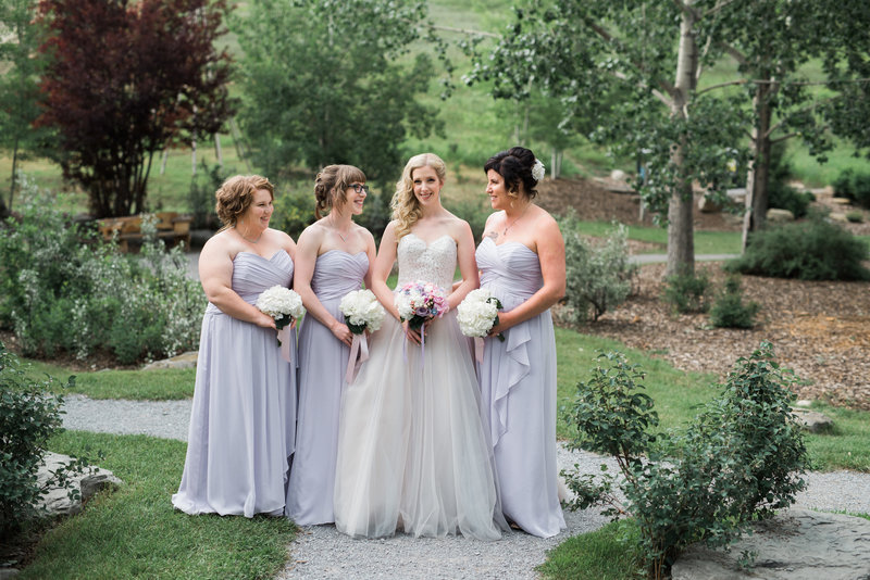 Red Deer Photographers-Raelene Schulmeister Photography- wedding photos-Outdoor Calgary wedding-Bridesmaids and Bride with bouquets-purple bridesmaid dresses