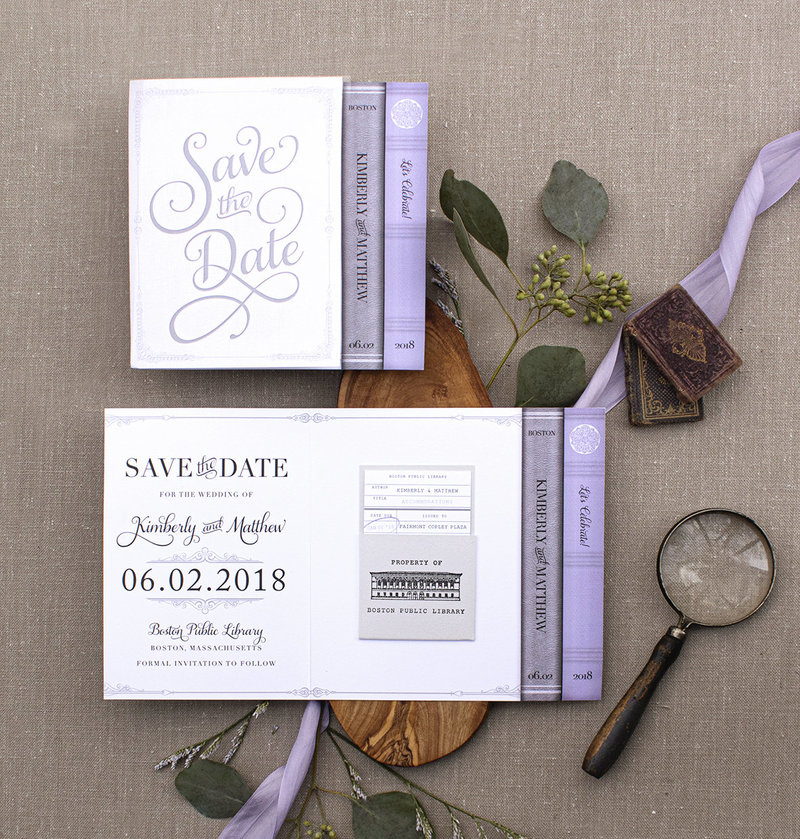 Folded library or book themed save the date featuring beautifully designed book ends and a library due date pocket stamped with a custom illustration of the Boston Public Library..