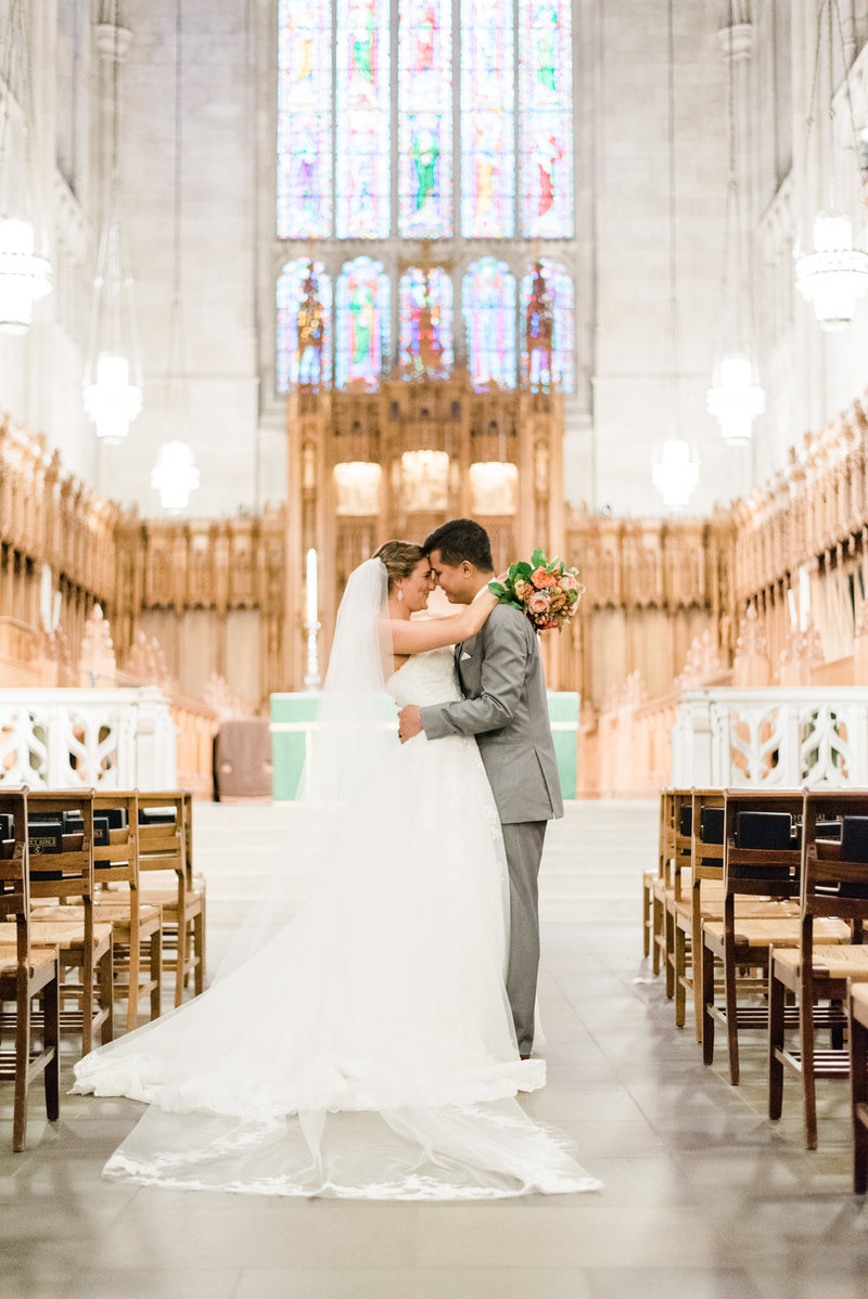 bride and groom in duke chapel wedding