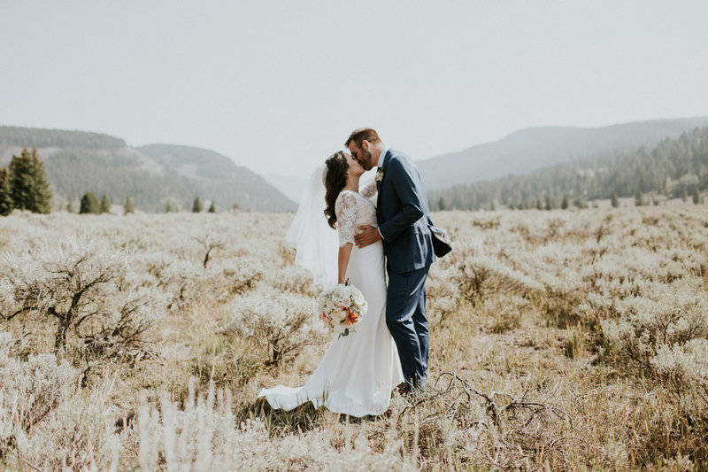Big Sky MT Wedding Couple Kissing in Sagebrush Field