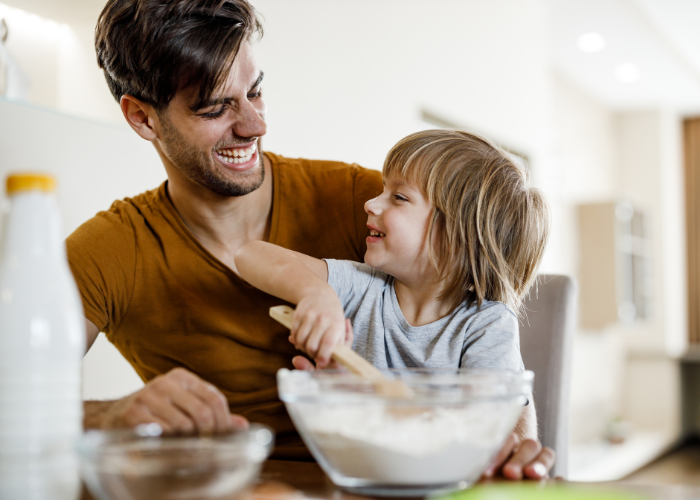 Thrive by Spectrum Pediatrics image for Yummy Toddler Food article ultimate guide to picky eaters is a child and father preparing food for mealtime
