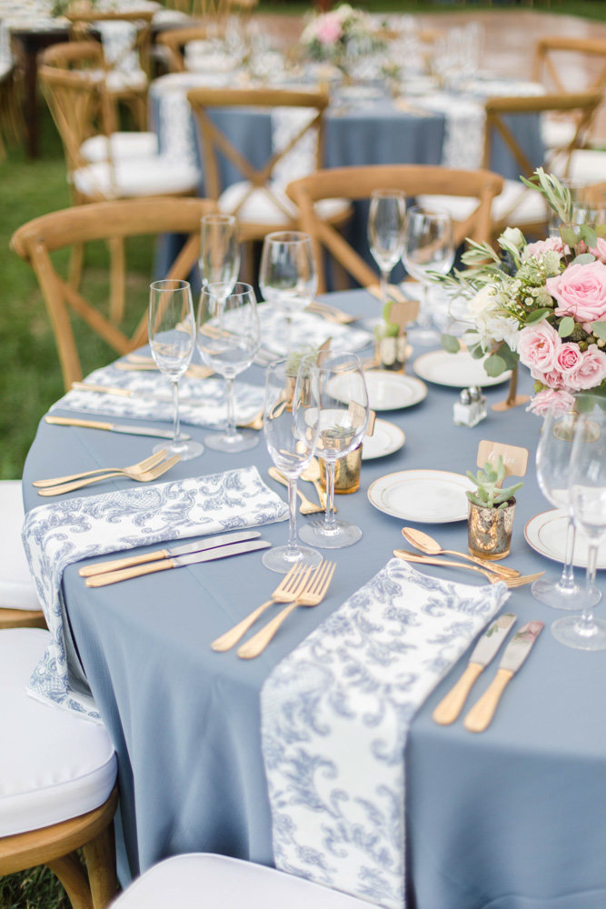 blue white and gold patterned table settings at eastern shore wedding at kirkland manor by costola photography