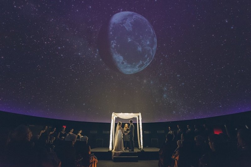 A wedding ceremony under the stars at the Franklin Institute, Philadelphia PA. The couple chose Donna Forsythe of Lehigh Valley Celebrants for their wedding officiant.