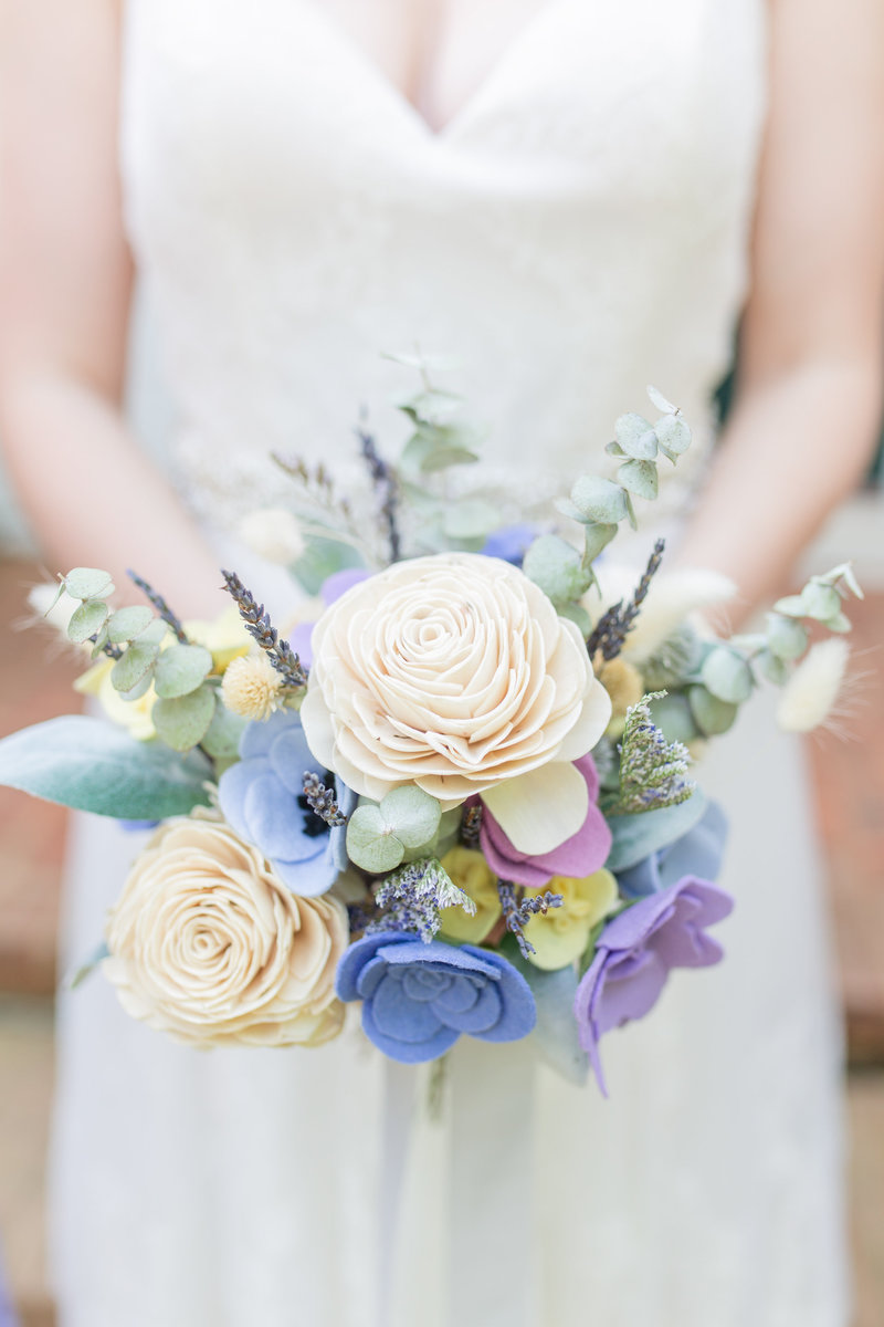 Photo of a bride holding a lavender bouquet at her Atlanta wedding by Jennifer Marie Studios.