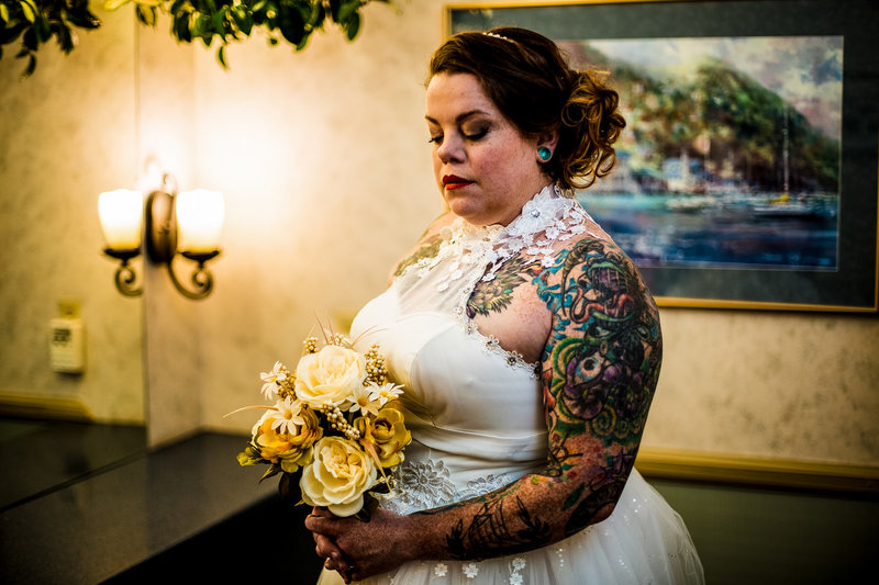 Bride standing with her bouquet at the Erie Yacht Club