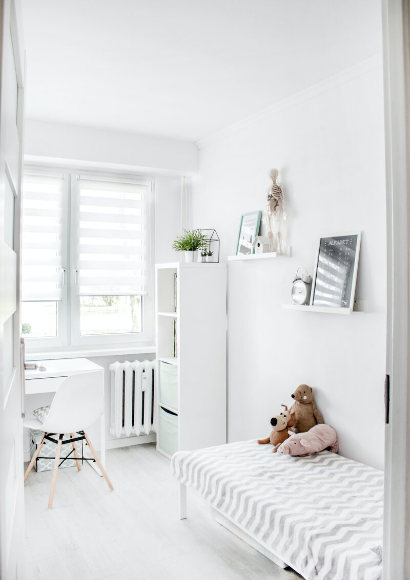plush-toys-on-top-of-white-and-grey-mattress-inside-bedroom-1139784