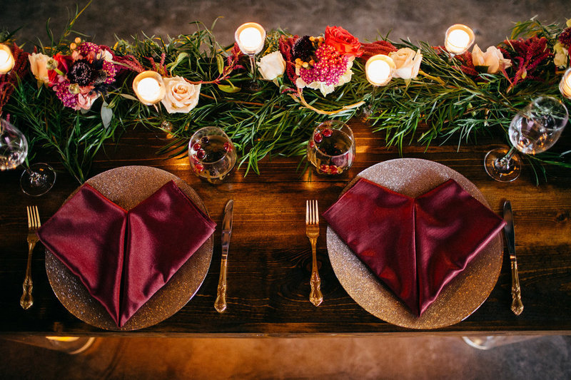 lakeland wedding. lakeland wedding planners. lakeland wedding venue. sweetheart table. burgundy and blush wedding. purple and blush wedding. gold flatware. gold chargers. farm tables.