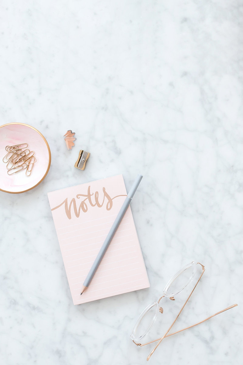 Marble counter, notepad flatlay