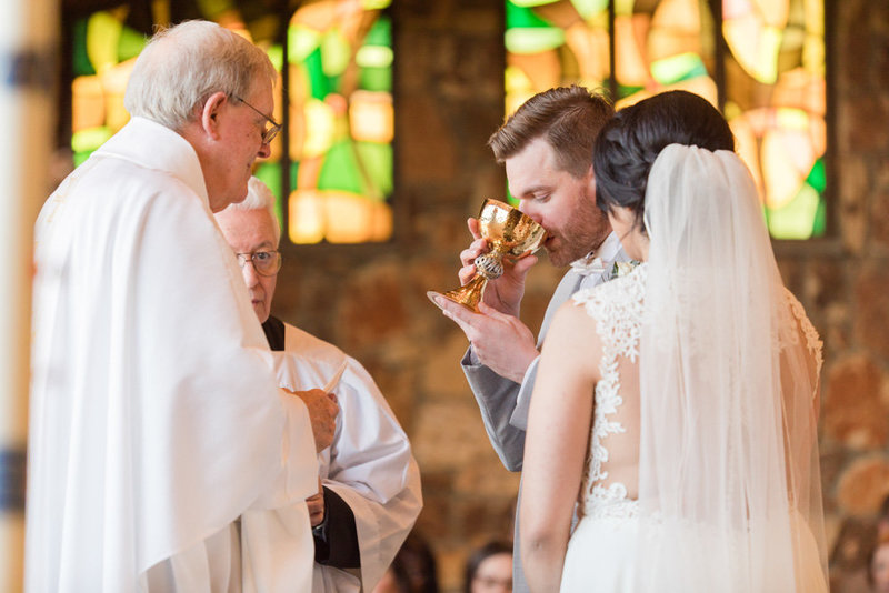 groom taking communion  at Stone House at Stirling Ridge Maryland Wedding by  Costola Photography