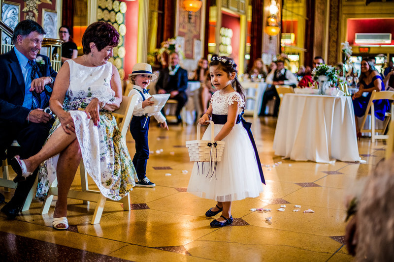 Flower girl marching down the aisle at Warner Theatre wedding