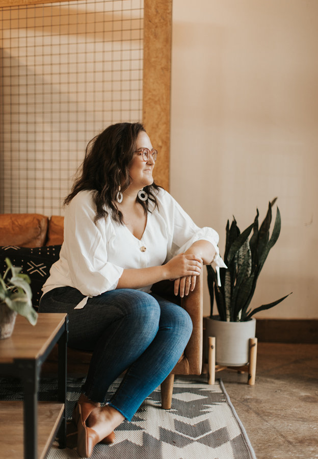 AnnaKate Auten, founder and designer at Rhema Design Co, staring off-screen.