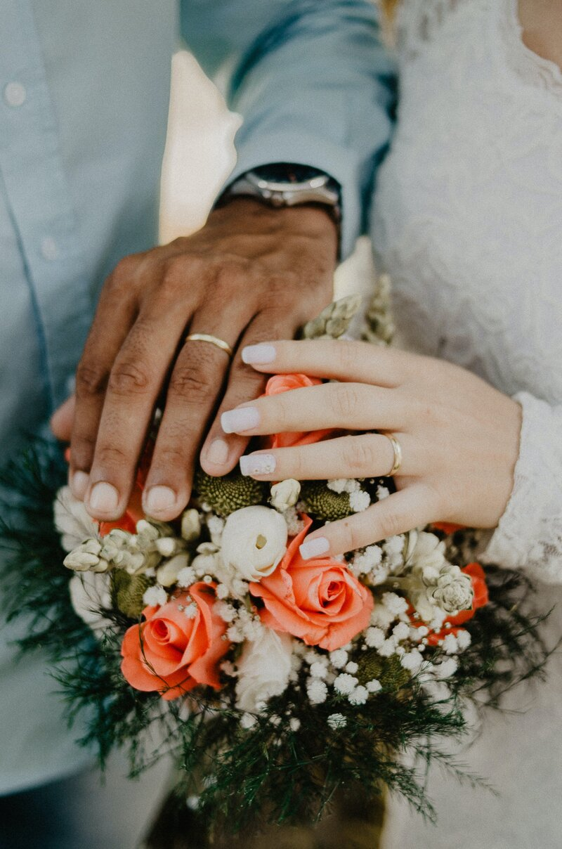 man-and-woman-s-hands-on-top-of-ball-bouquet-1730877