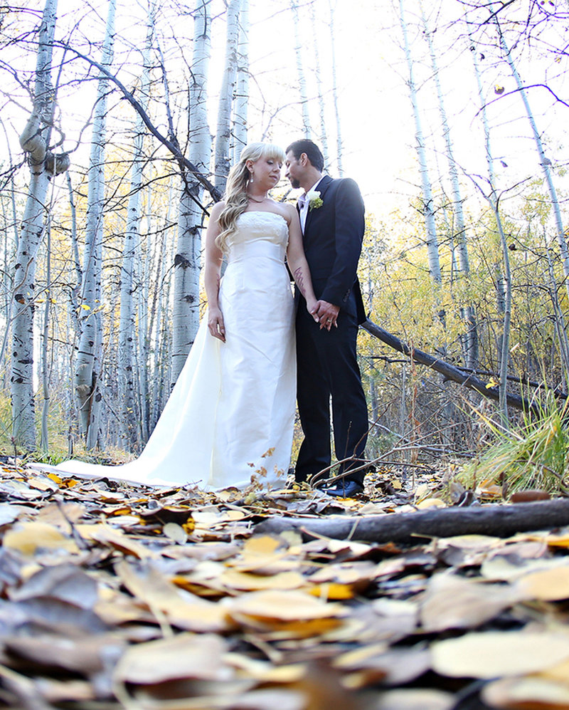 bride and groom in aspens